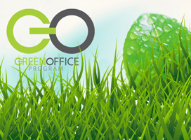 Green grass and a leaf with the Green Office logo tucked in behind